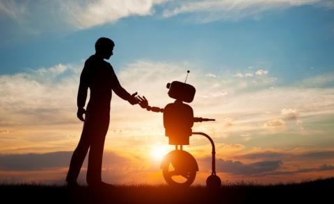 Man and AI robot meet and handshake with sunset sky behind © PHOTOCREO Michal Bednarek - shutterstock