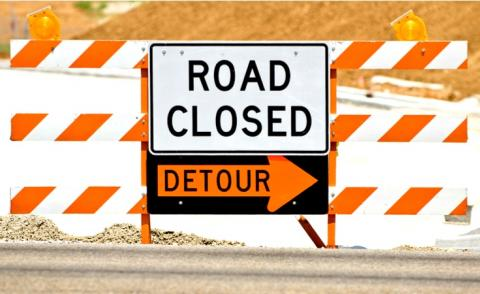 Road closed barriers with detour sign © Carolyn Franks - shutterstock