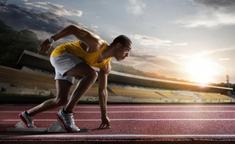 Sprinter leaving starting blocks on running track © Rocksweeper - shutterstock