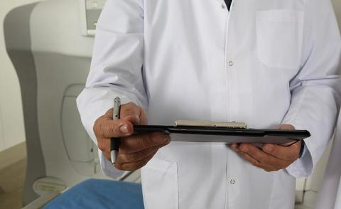 Image of a doctor with an iPad