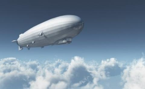Airship over clouds 3D illustration © Michael Rosskothen - shutterstock