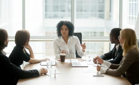 Woman leads business discussion with diverse participants © fizkes - shutterstock
