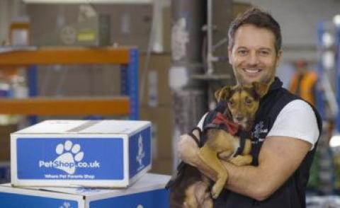 Adam Taylor co-founder PetShop with canine chum