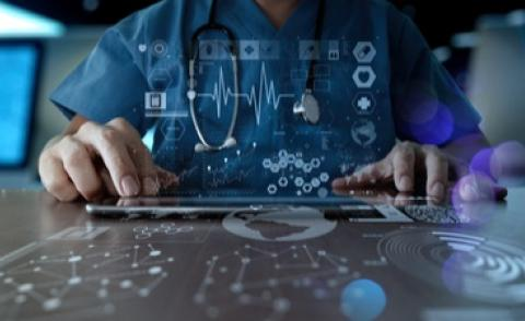 Doctor working with modern digital healthcare interface © everything possible - shutterstock