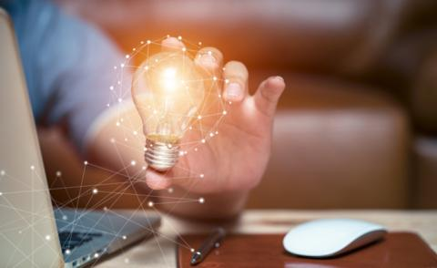 Hand of business woman at laptop holding lightbulb innovation concept © Witthaya lOvE - shutterstock