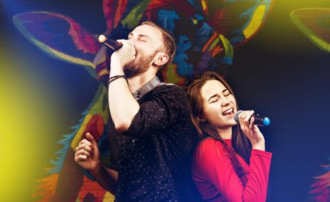 Man and woman sing duet with colorful background © Dmitry Molchanov - shutterstock