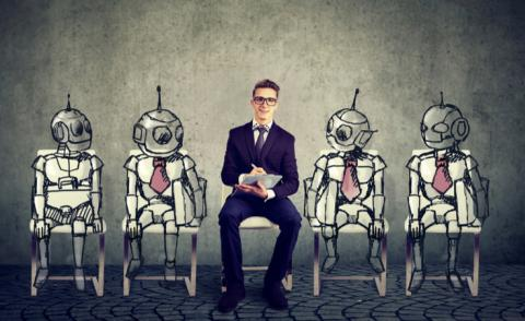 Cartoon robots look at young man lined up for job interview © pathdoc - shutterstock