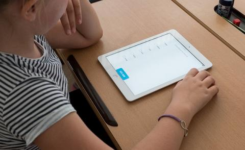 Image of a student learning from an iPad