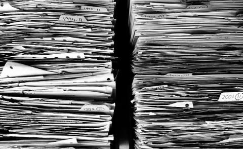 Image of a pile of paper and data