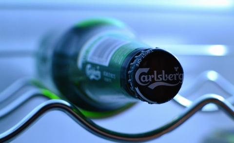 An image of a Carlsberg beer bottle in a fridge