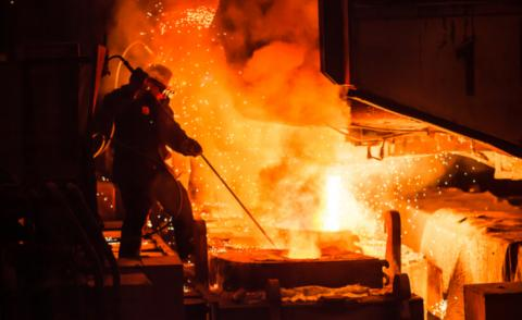 Man works with molten metal in electric furnaces © Norenko Andrey - shutterstock