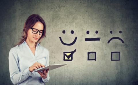 Happy business woman giving excellent rating for customer or work experience survey © pathdoc - shutterstock