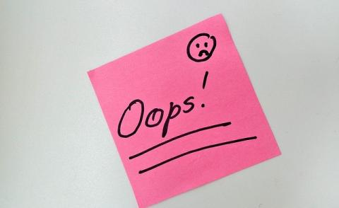Image of a post-it note saying 'oops'