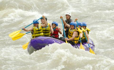 Tourists white water rafting with guide in Ecuador © Ammit Jack - shutterstock