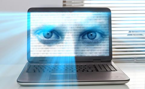 Privacy threat at work - laptop with eyes in screen © Juergen Faelchle - shutterstock