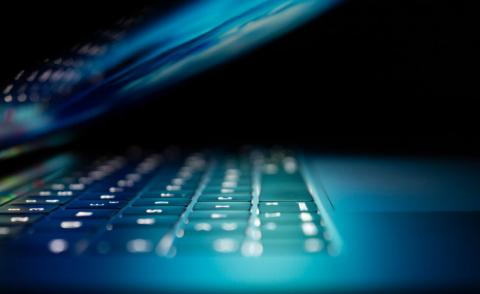 Close up of laptop with blue light from screen - Photo by Philipp Katzenberger on Unsplash