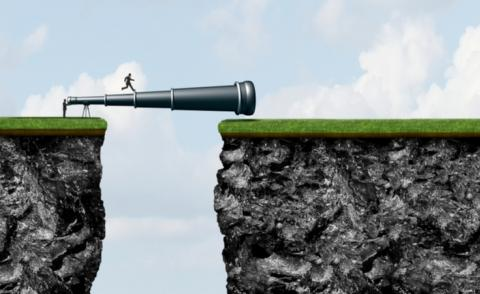 Business man crosses chasm over telescope while another looks through © Lightspring - shutterstock
