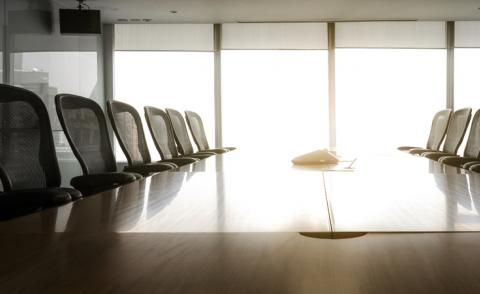 Image of morning sunrise shine on empty boardroom seats
