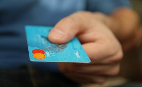 Image of a person paying by card