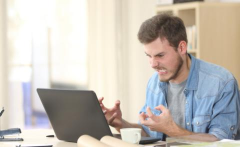 Remote worker at home is angry at laptop © Antonio Guillem - shutterstock