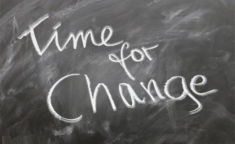 Image with the words 'time for change' written on a chalk board