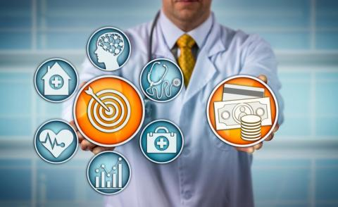 Diagnostician with icons representing value-based health care © LeoWolfert - shutterstock