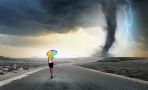 Confident business woman walks towards terrible storm © Sergey Nivens - shutterstock