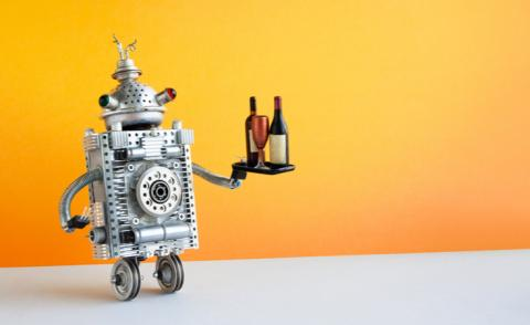 Restaurant automation service concept robot waiter serving bottles and wine glass © Besjunior - Shutterstock