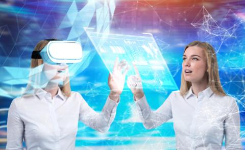 Business woman in VR headset while twin consults business data © ImageFlow - shutterstock