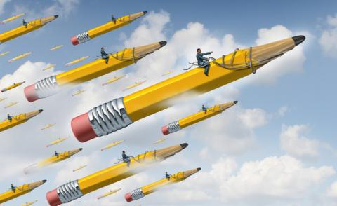 Continuous planning concept, businessman on giant yellow flying pencil leads team © Lightspring - shutterstock