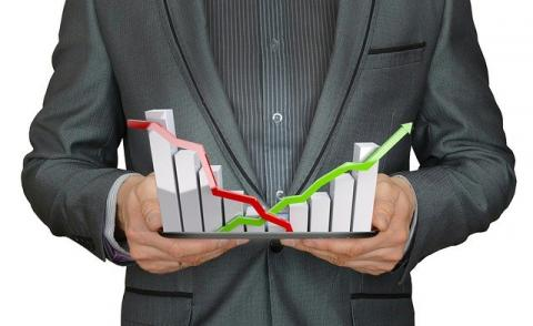 Image of a man holding growth charts