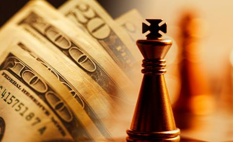 US dollars and chess concept © isak55 - Shutterstock