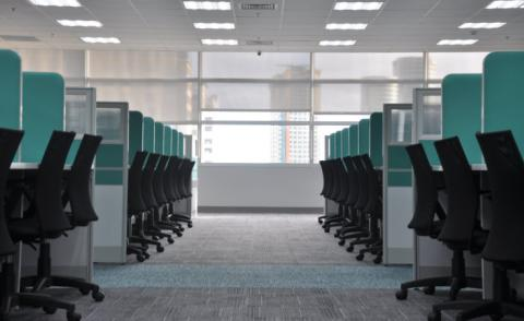 Row of empty chairs at office cubicles - Photo by kate.sade on Unsplash