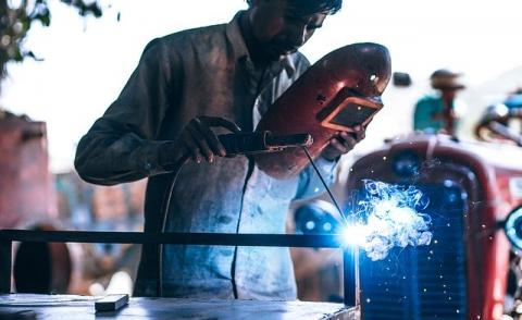 Image of someone welding in a manufacturing plant