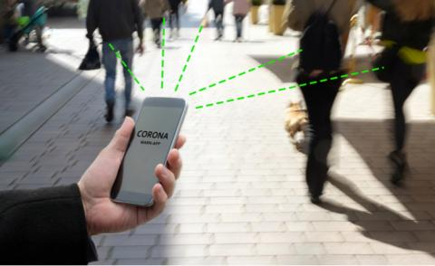 Smart phone running COVID-19 contact tracking app in city street © Maren Winter - shutterstock