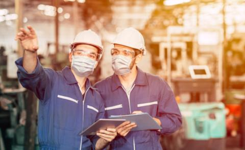 Engineers wearing face masks prepare factory re-opening © Quality Stock Arts - shutterstock