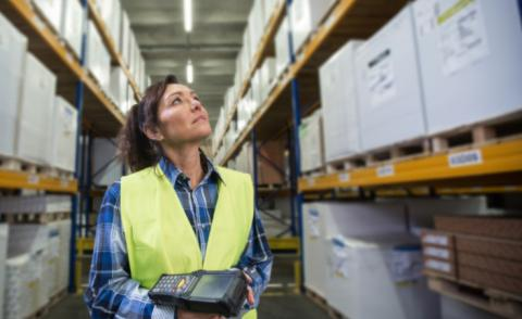 Woman with scanner checking inventory levels © urbans - Shutterstock