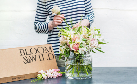 Image of someone arranging a Bloom & Wild bouquet