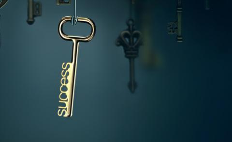 Conceptual image with hanging keys and one shining key © zffoto - Shutterstock