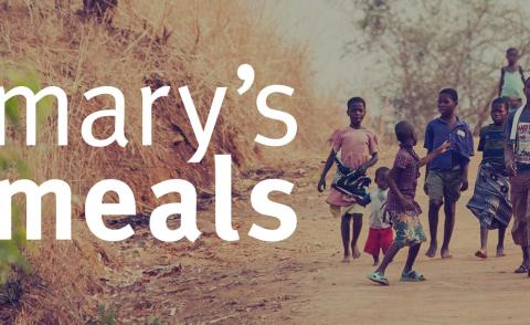 Image of Mary's Meals logo and some kids on a dirt path
