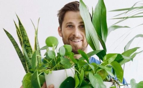 Image of a man holding some plant pots