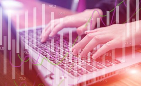 Hands type on keyboard overlaid with finance charts - Image by Nattanan Kanchanaprat from Pixabay