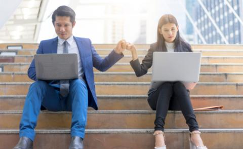Business teamwork - man and woman fist bump sitting on steps with laptops © Ultimate Photo - shutterstock