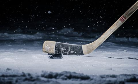 Hockey stick and puck on an ice rink © Vasilev Evgenii - shutterstock