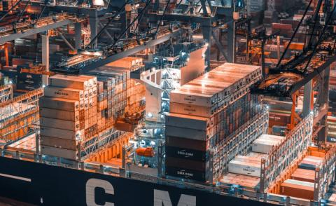 Industrial port with containers in Hong Kong - Photo by TimeLab Pro on Unsplash