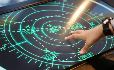 Hand of aviation controller navigating screen © MR.Yanukit - Shutterstock