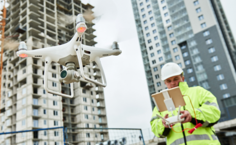 Drone operated by construction worker on building site © Dmitry Kalinovsky - Shutterstock