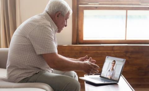 Older man on video call with doctor therapist © fizkes - shutterstock