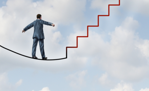 Adapting to change as a business idea with a man walking on tightrope that transforms into a staircase © Lightspring - Shutterstock