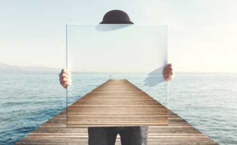 Man holding surreal painting of a boardwalk © fran_kie - Shutterstock